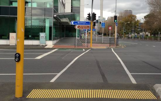 Controlled pedestrian crossing with tactile paving raised domes