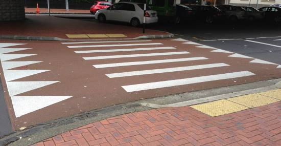 Raised crossing with tactile paving