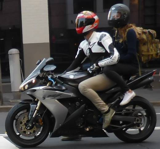 motorbike with pillion passenger