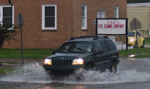 suv driving through flood water