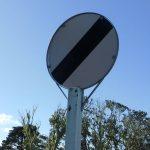 speed limit derestriction sign