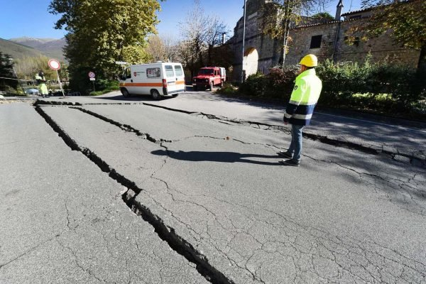 An earthquake can cause large cracks in the road like this